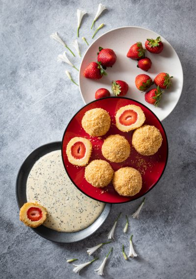 Yoghurt and strawberry dumplings with poppy seed custard