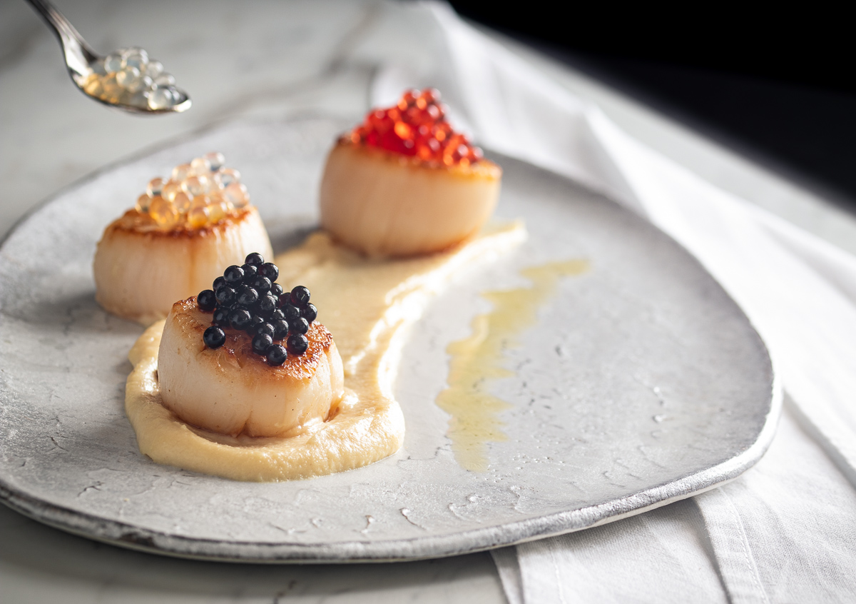Scallops on buttery parsnips with 'caviar'