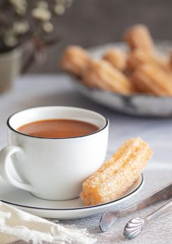 Spiced churros with white chocolate toffee sauce